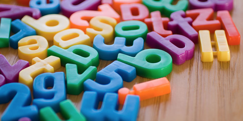 Plastic number and letter magnets in a variety of colors.