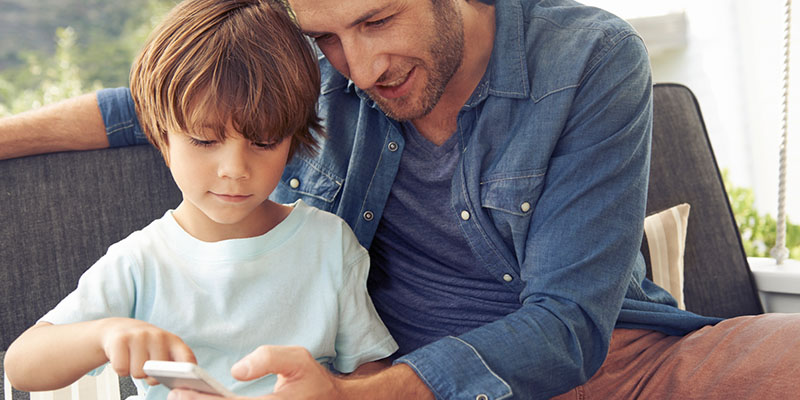 Parent and son sharing an iPhone